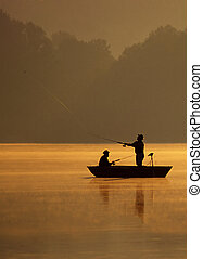 Casting For Fish - A pair of anglers are fishing on a ...