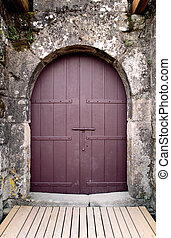 Castle door - Old brown castle door seeing weathered granite...