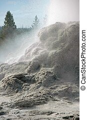 Eruption of Castle Geyser, spewing water over its terraces