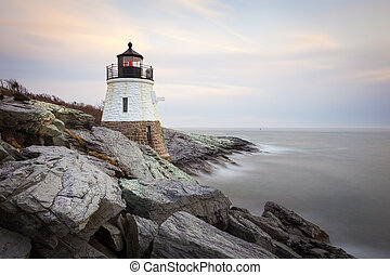 Castle Hill Lighthouse at sunset in Newport, Rhode Island, USA.