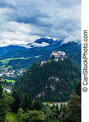 Castle Hohenwerfen by Salzburg on a misty mountain in the Alps