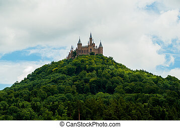 Castle Hohenzollern on the green hill.