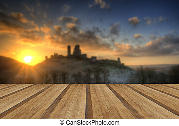 Castle in landscape Winter sunrise with wooden planks floor