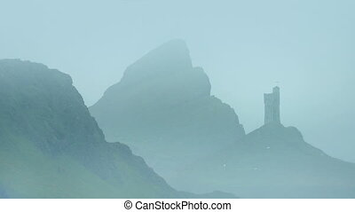 Castle In Misty Mountains - Barren mountain landscape with...