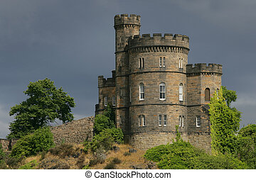 Castle on a hill in Edinburgh, Scotland. Shot on an overcast day just as the sun came out behind me and illuminated the castle.