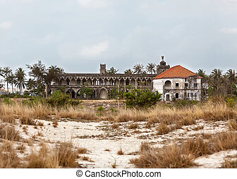 castle in the sand among the palm trees