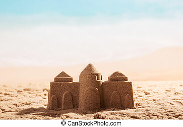 Castle in the sand close up on background of sea.