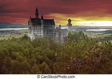 Castle Neuschwanstein at sunset with dramtic sky