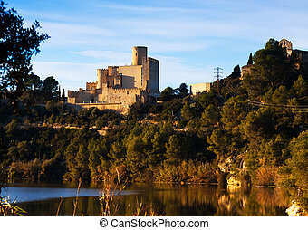 Castle of Castellet and the Hermitage of St. Peter from lake...