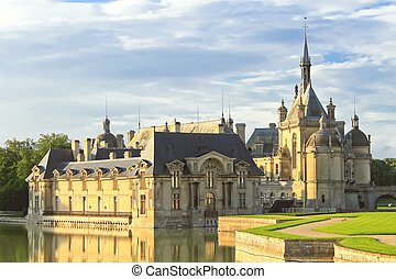 Castle of Chantilly at sunset. France