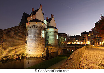 Castle of the Dukes of Brittany (Ch?teau des ducs de Bretagne) by night in Nantes, France