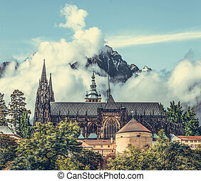 Castle on a background of rocky mountains.