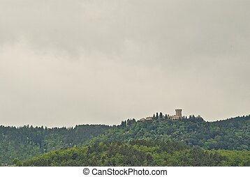 Castle on a hill in Tuscany, Italy.