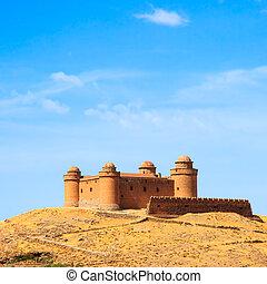 Castle on hill, medieval Castillo de La Calahorra and...