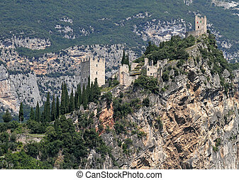 Castle on limestone cliff in Arco in Trentino, Italy, Europe