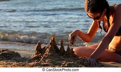 Castle on the Beach Made From Sand - Sandy Beach. Girl...