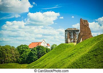 Castle ruins during renovation summer landscape