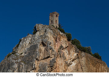 Castle ruins in Tuscany on a rock