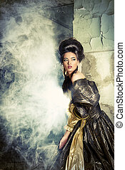 castle ruins - Art Fashion. Beautiful young woman in elegant...