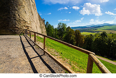 castle wall and railing on a hill. view in to the beautiful...