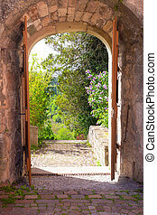 arched entryway leads into landscape garden