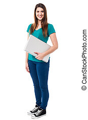 Casual attractive girl holding laptop