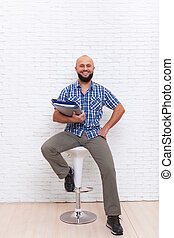 Casual Bearded Business Man Holding Folder Sitting Chair
