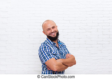 Casual Bearded Man Smiling Folded Hands