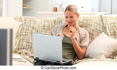 Casual blond woman working