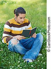 Casual boy reading