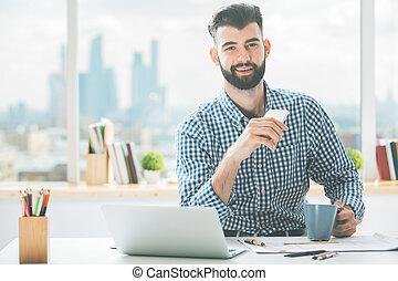 Casual boy using cellphone