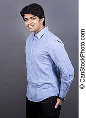casual business man - handsome east indian man wearing blue...