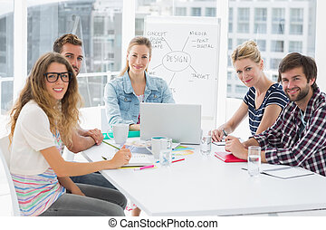 Casual business people around conference table in office -...