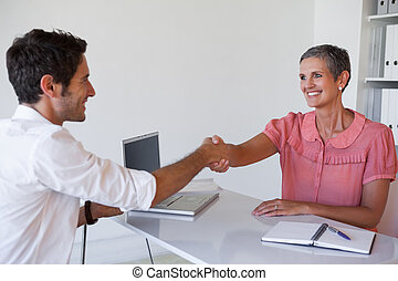 Casual business people shaking hand