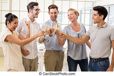 Casual business team celebrating with champagne