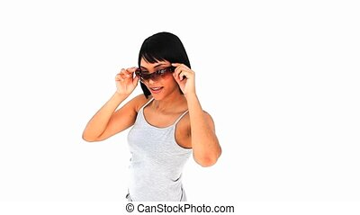 Casual chinese woman with sunglasses against a white...