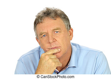 Casual middle aged man with hand on chin with a concerned look.
