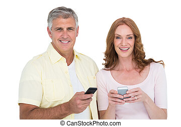 Casual couple sending text messages on white background