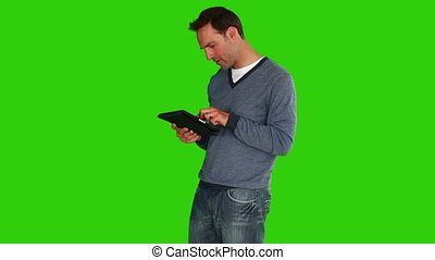 Casual dark-haired man using a touch pad - Chromakey footage...