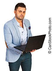 Casual executive using laptop