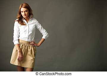 Image of gorgeous woman in smart casual looking at camera