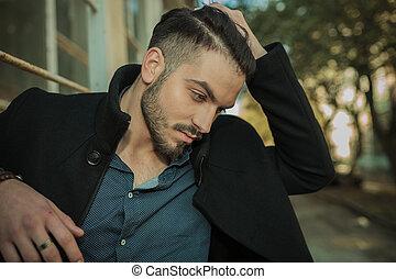 Casual fashion man looking down