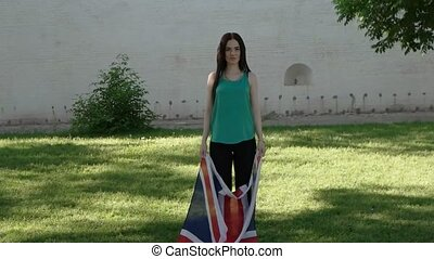 Casual girl having fun with GB flag. Women Dances with Union Jack.