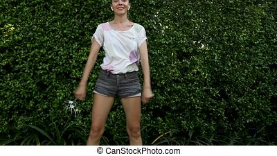 Casual girl showing Backpack Kid Dance - Slim woman in...