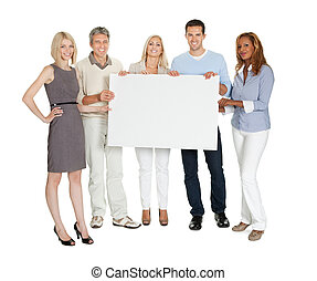 Casual group of people holding a billboard