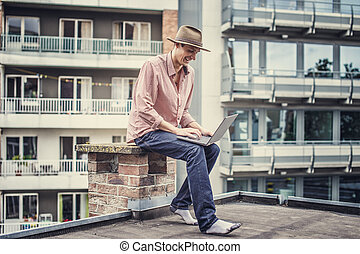 Casual guy with laptop.