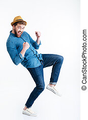 Casual handsome man dancing over white background
