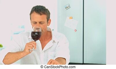 Casual man enjoying a glass of red