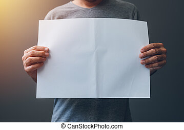Casual man in gray t-shirt with blank paper