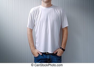 Casual man in jeans trousers and white t-shirt
